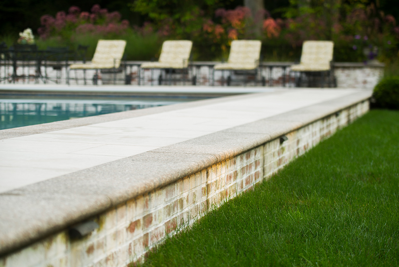 The LaurelRock Company - Residential Landscaping in CT - Back Country Manor - Pool Platform and Exterior Lighting
